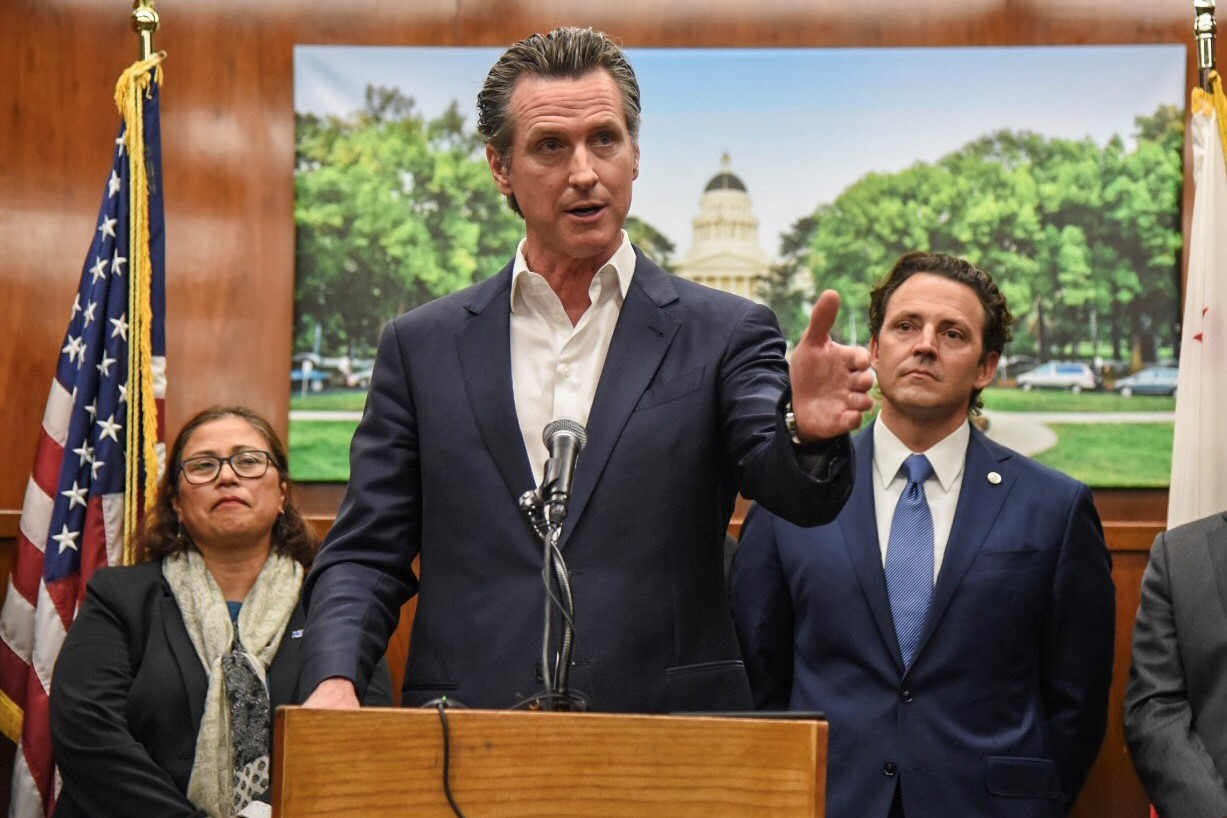 Governor Newsom speaks from a podium