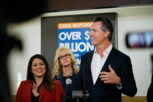Governor Newsom makes remarks at a podium.