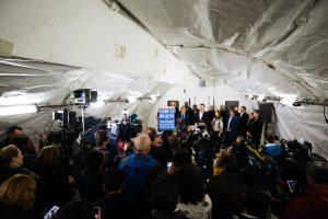 Governor Newsom speaks at a podium while press listens.