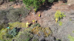 This is an aerial view of several crew members working on an emergency project.