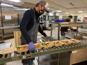 Governor Newsom prepares food at St. Anthony's on Martin Luther King Jr. Day.