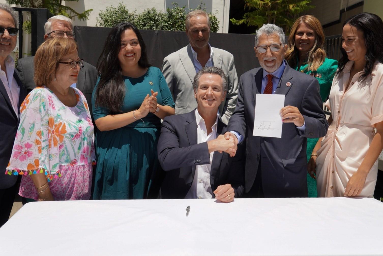 Governor alongside legislators and film and tv industry leaders