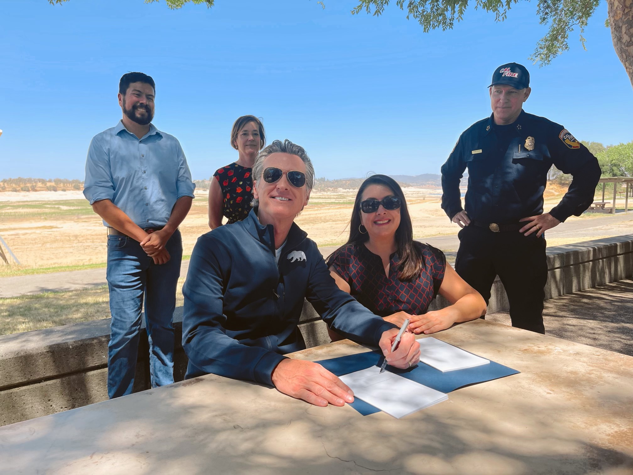 Governor signs bill outdoors