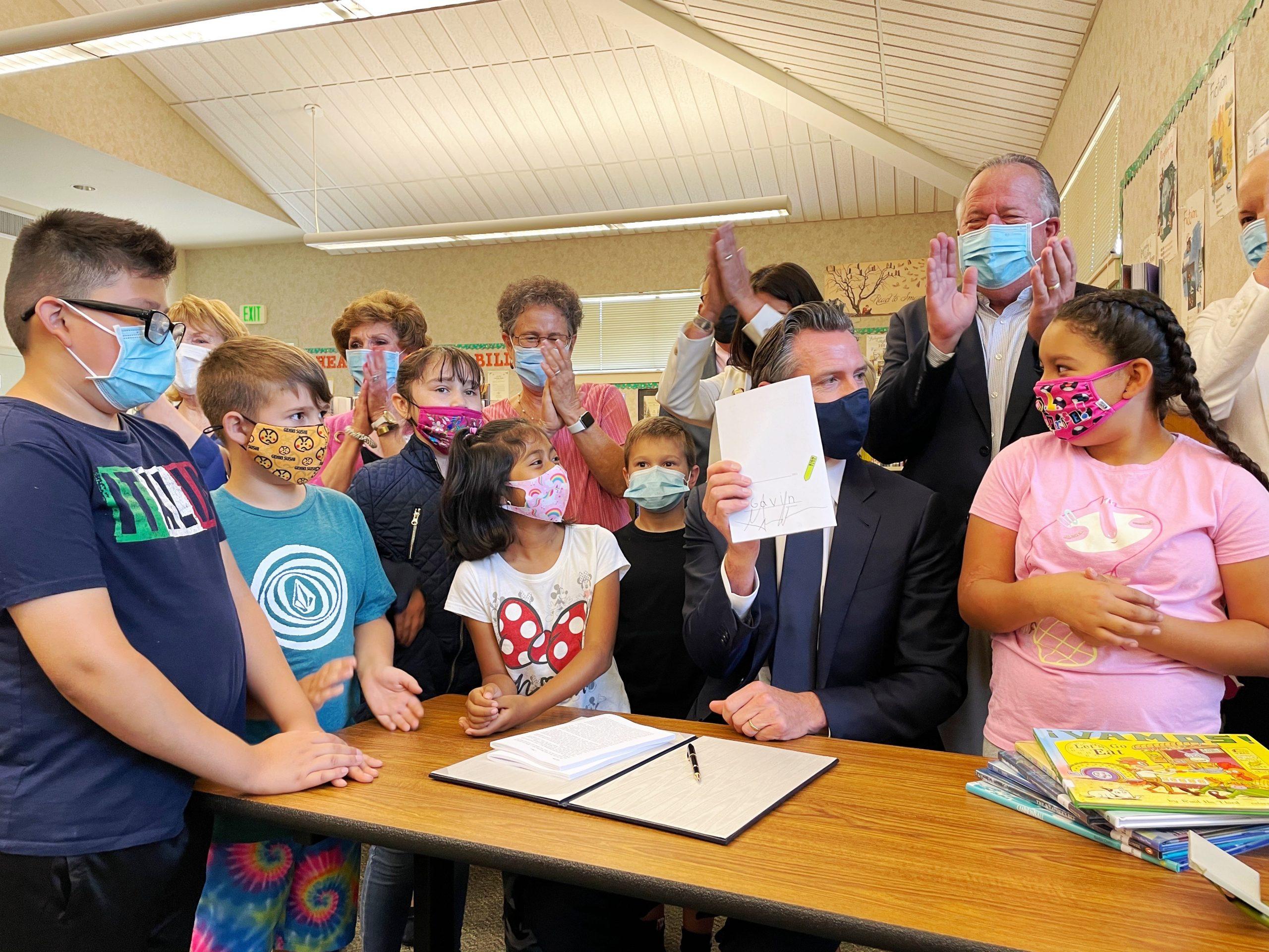 Gov signs bill at elementary school