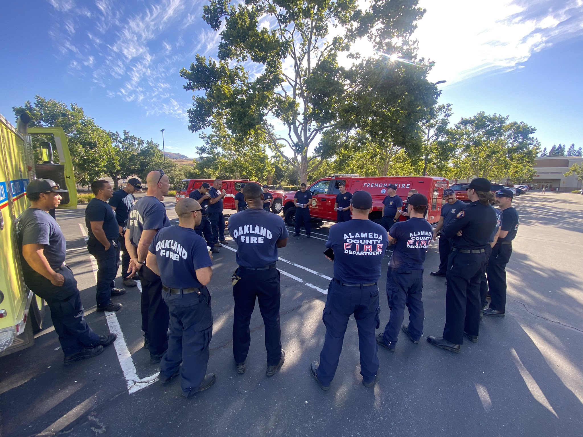 Fire personnel from Fremont, Hayward, Alameda and Oakland in a circle