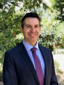 E. Carlos Dominguez